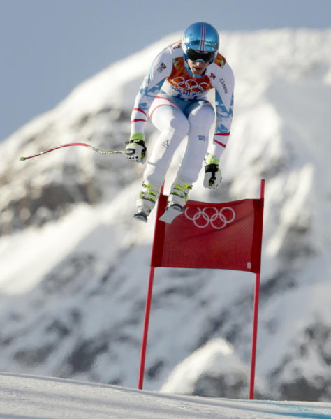 Austria's Matthias Mayer makes a jump during a men's downhill training run for the Sochi 2014 Winter Olympics, Friday, Feb. 7, 2014, in Krasnaya Polyana, Russia. (AP Photo/Charles Krupa)