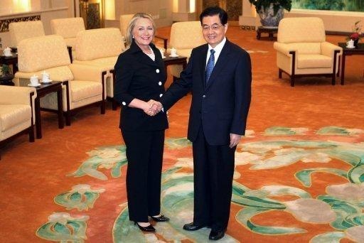 China's President Hu Jintao (R) greets US Secretary of State Hillary Clinton at the Great Hall of the People. China promised to ensure freedom of navigation in the tense South China Sea and told Clinton it was willing to work on a code of conduct to manage disputes