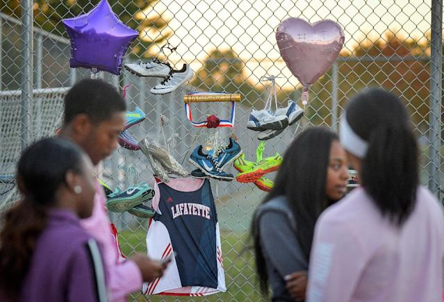 Friends gather during a candlelight vigil at Lafayette High School for Trinity Gay, the daughter of Olympic sprinter Tyson Gay, who died in an exchange of gunfire early Sunday morning, in Lexington, Kentucky, October 17, 2016. REUTERS/Bryan Woolston