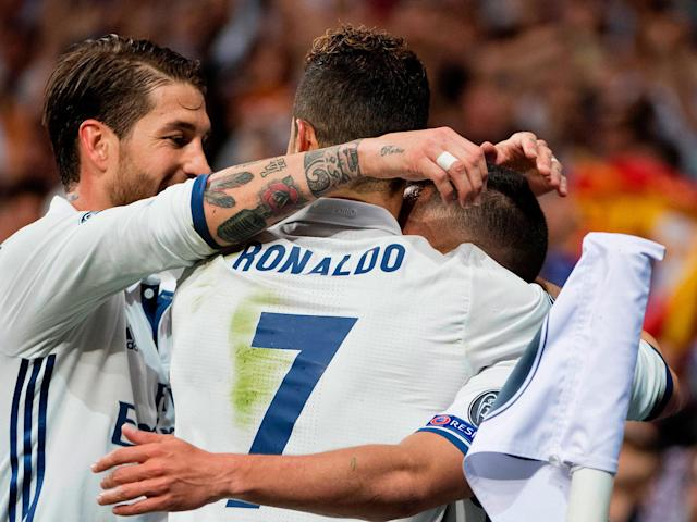 Ronaldo celebrates with his team-mates after scoring Real's first: Getty