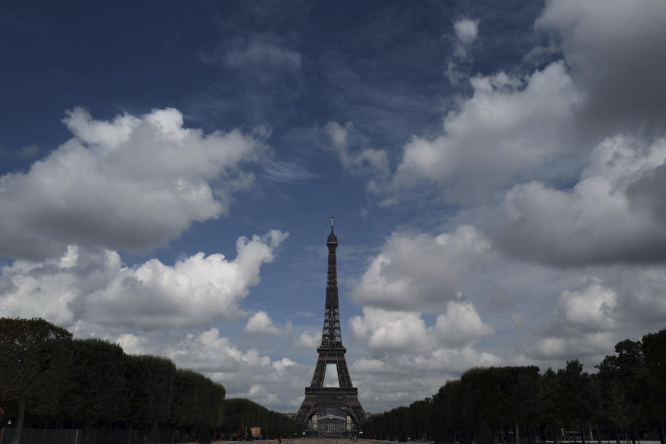 The Eiffel Tower is pictured from the Champ de Mars side during the opening up of the top floor of the Eiffel Tower, Wednesday, July 15, 2020 in Paris. The top floor of Paris' Eiffel Tower reopened today as the 19th century iron monument re-opened its first two floors on June 26 following its longest closure since World War II. (AP Photo/Francois Mori)