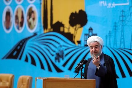 Iranian President Hassan Rouhani gestures as he delivers a speech during the Conference of Government's Achievements in Developing Rural Infrastructure in Tehran