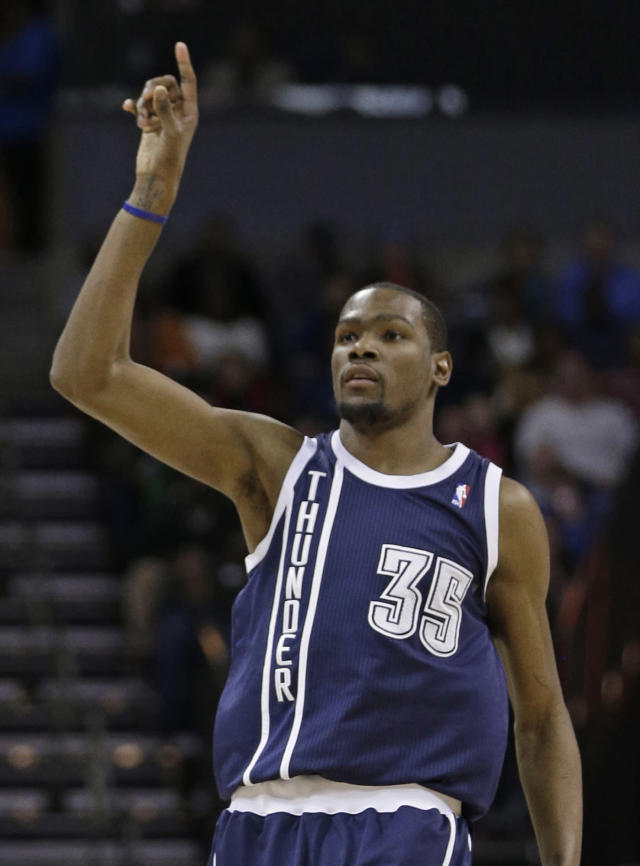 Oklahoma City Thunder's Kevin Durant (35) rgestures after making a 3-point shot against the Charlotte Bobcats during the second half of an NBA basketball game in Charlotte, N.C., Friday, Dec. 27, 2013. The Thunder won 89-85. (AP Photo/Chuck Burton)