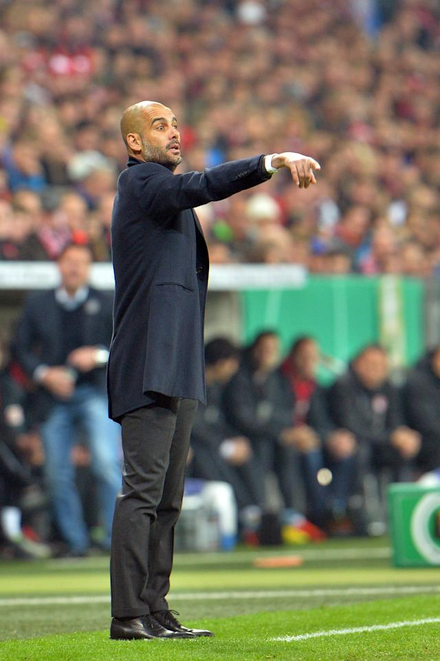 Munich head coach Pep Guardiola points during the German soccer cup, DFB Pokal, semifinal match between FC Bayern Munich and FC Kaiserslautern in the Allianz Arena in Munich, Germany, on Wednesday, April 16. 2014. (AP Photo/Kerstin Joensson)