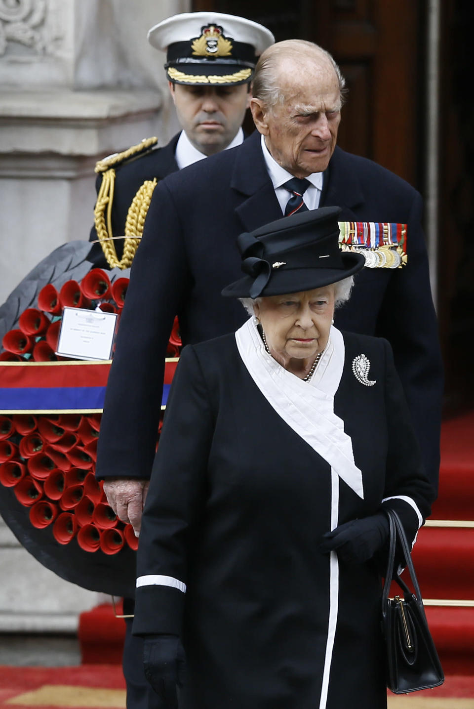 FILE - In this file photo dated Saturday, April 25, 2015, Britain's Queen Elizabeth II and Prince Philip, arrive to attend a ceremony at the Cenotaph to commemorate ANZAC Day and the Centenary of the Gallipoli Campaign in Whitehall, London. The ANZAC Day memorial Saturday marks the 100th anniversary of the 1915 Gallipoli landings, the first major military action fought by the Australian and New Zealand Army Corps during World War I. Prince Philip who died Friday April 9, 2021, aged 99, lived through a tumultuous century of war and upheavals, but he helped forge a period of stability for the British monarchy under his wife, Queen Elizabeth II. (AP Photo/Kirsty Wigglesworth, FILE)