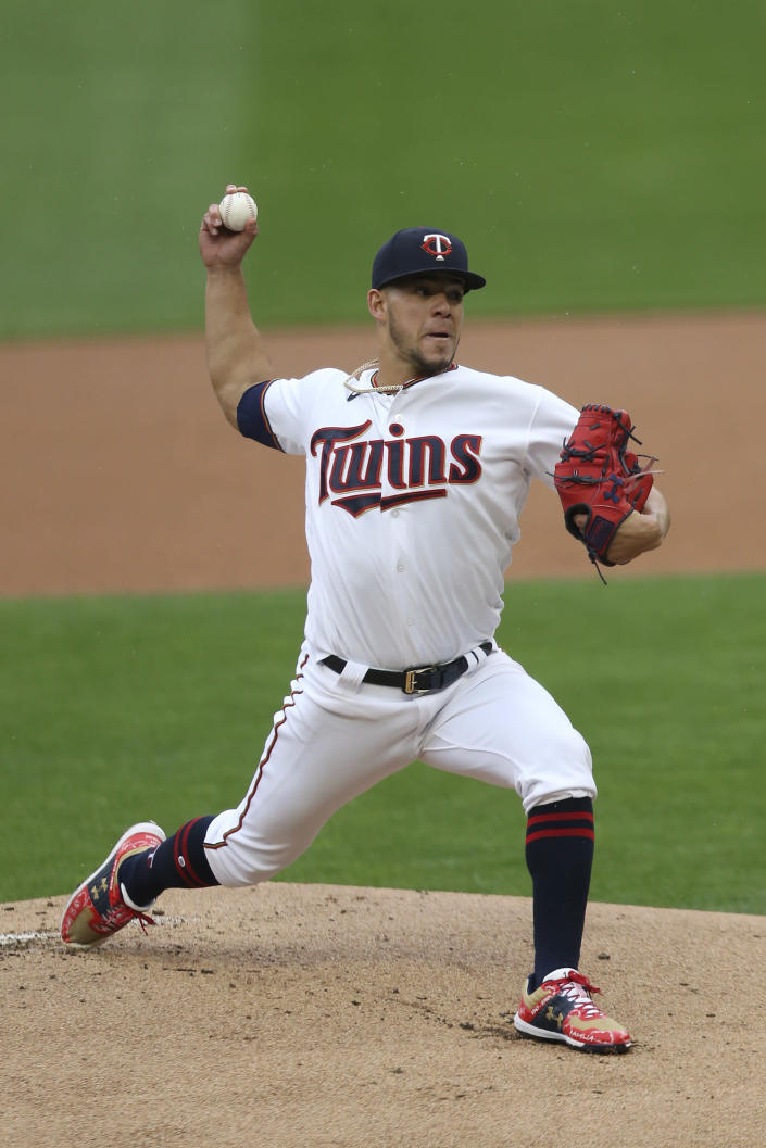 Minnesota Twins pitcher Jose Berrios throws against the Kansas City Royals during the first inning of a baseball game, Sunday, May 2, 2021, in Minneapolis. (AP Photo/Stacy Bengs)