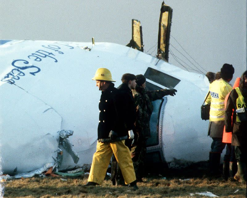 FILE PHOTO: A December 23, 1988 file photo shows Scottish rescue workers and crash investigators search area in Lockerbie.