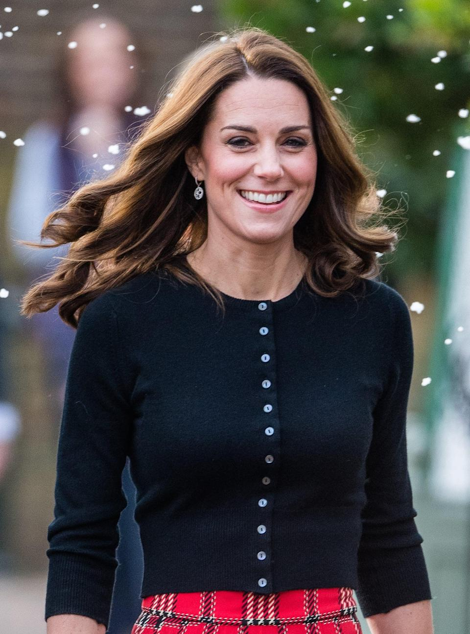 <p>Middleton was seen walking through the (fake) snow for a very Christmas-themed visit wearing her hair in tight spirals that went from mid-lengths to ends. </p>