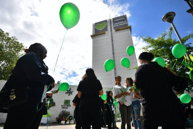 People release balloons at the Grenfell Memorial Community Mosaic (Victoria Jones/PA)