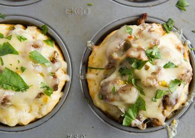 """<div class=""""caption-credit""""> Photo by: Photo by Kimberley Hasselbrink</div><div class=""""caption-title""""></div><b>Spicy Beef and Cheese Muffins</b> <br> <br> Drop biscuit batter in the bottom of buttered muffin tins, top with cooked ground beef tossed with minced pickled jalapenos and finish with a big pinch of shredded pepper jack cheese. Bake in a 350° oven until the dough is done and the cheese melts, about 15 minutes. Sprinkle with chopped cilantro."""