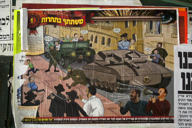 "In this Sunday, July 14, 2013 photo, a poster is seen in the ultra-Orthodox Jewish Mea Shearim neighborhood in Jerusalem, depicting Haredi soldiers rolling through the streets atop tanks trying to lure young boys onto their vehicles. The ad denounces the soldiers as Zionist ""ambassadors"" and ""missionaries."" The soldiers in sidecurls have been coined the insulting nickname ""Hardak"" _ a combination of Haredi and insect. (AP Photo/Sebastian Scheiner)"