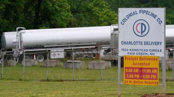 PHOTO: Tanker trucks are parked near the entrance of Colonial Pipeline Company, May 12, 2021, in Charlotte, N.C. (Chris Carlson/AP)