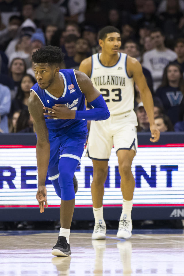 Seton Hall's Myles Cale, left, reacts to his three-point shot over Villanova's Jermaine Samuels, right, during the first half of an NCAA college basketball game, Sunday, Jan. 27, 2019, in Philadelphia. (AP Photo/Chris Szagola)