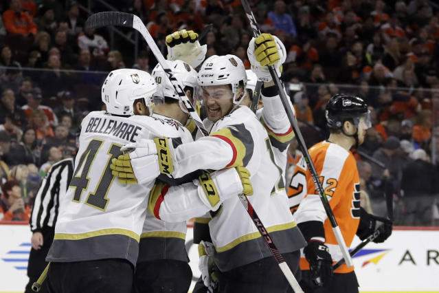 Vegas Golden Knights' Pierre-Edouard Bellemare (41), Ryan Carpenter (40) and Jon Merrill (15) celebrate past Philadelphia Flyers' Michael Raffl (12) after Carpenter's goal during the third period of an NHL hockey game, Monday, March 12, 2018, in Philadelphia. (AP Photo/Matt Slocum)