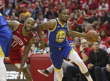 May 4, 2019; Houston, TX, USA; Golden State Warriors forward Kevin Durant (35) dribbles the ball past Houston Rockets forward PJ Tucker (17) during the second quarter in game three of the second round of the 2019 NBA Playoffs at Toyota Center. Mandatory Credit: Troy Taormina-USA TODAY Sports