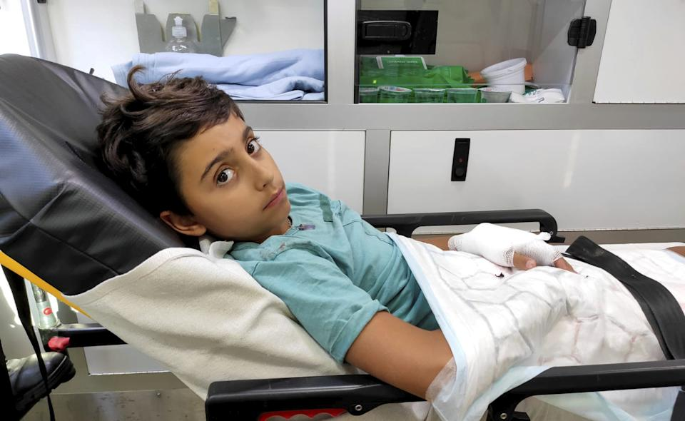Oliver Quarte was paralysed and needed emergency surgery after he sliced the tendons in his hand  while skimming stones at the seaside (SWNS)