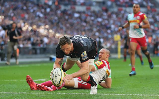 <span>Chris Ashton beats Mike Brown to the ball</span> <span>Credit: GETTY IMAGES </span>