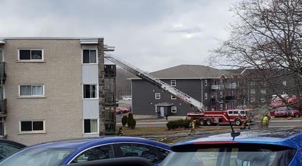 A file photo of firefighters working on a blaze at an apartment building on Onondaga Street last April, the same street where Thursday night's fire occurred