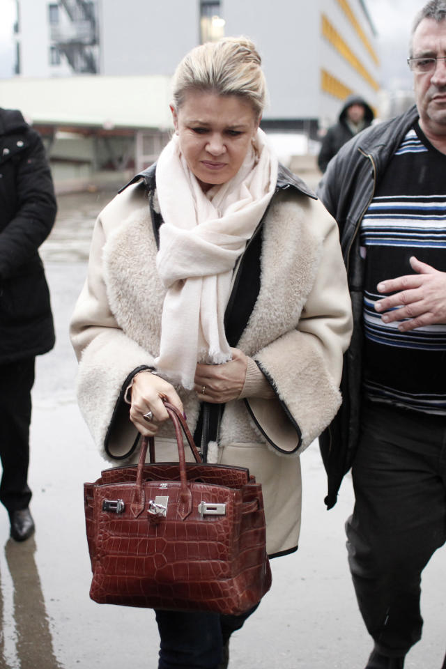 Michael Schumacher's wife, Corinna arrives at the Grenoble hospital, French Alps, Friday, Jan. 3, 2014, where former seven-time Formula One champion Michael Schumacher is being treated after sustaining a head injury during a ski accident. Schumacher's condition is reported to be stable but still critical as he remained unconscious, his manager said Wednesday. (AP Photo/Thibault Camus)
