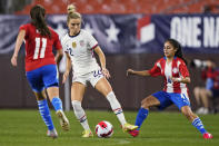 U.S. midfielder Kristie Mewis (22) moves the ball between Paraguay's Mirta Pico (11) and Daysy Bareiro (4) during the first half of an international friendly soccer match Thursday, Sept. 16, 2021, in Cleveland. (AP Photo/Tony Dejak)