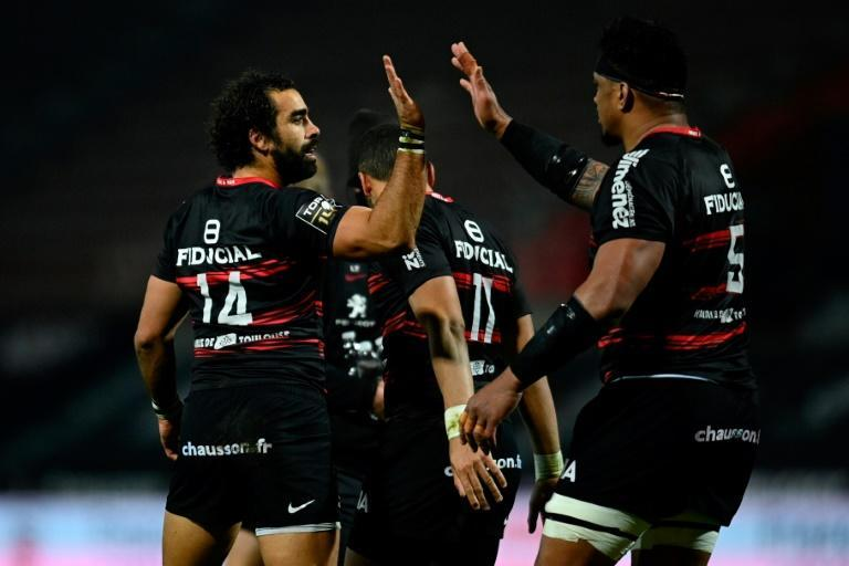 High five: Toulouse's French wing Yoann Huget celebrates with teammates after scoring a try