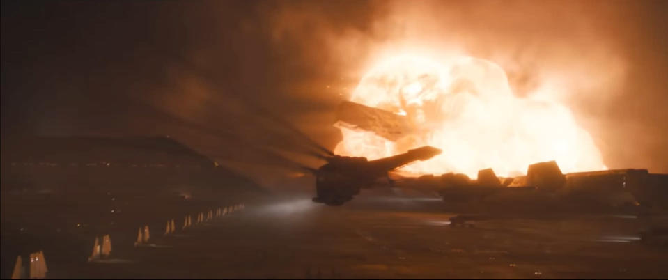 A thopter in front of an explosion