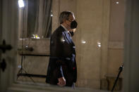 Former European Central Bank President Mario Draghi iOS framed by a window as he arrives at the Quirinale presidential palace for talks with Italian President Sergio Mattarella, in Rome, Friday, Feb. 12, 2021. Draghi has secured pledges of backing from nearly every party in the Italian Parliament as he wrapped up political consultations aimed at giving the pandemic-ravaged nation a new government. (AP Photo/Andrew Medichini)