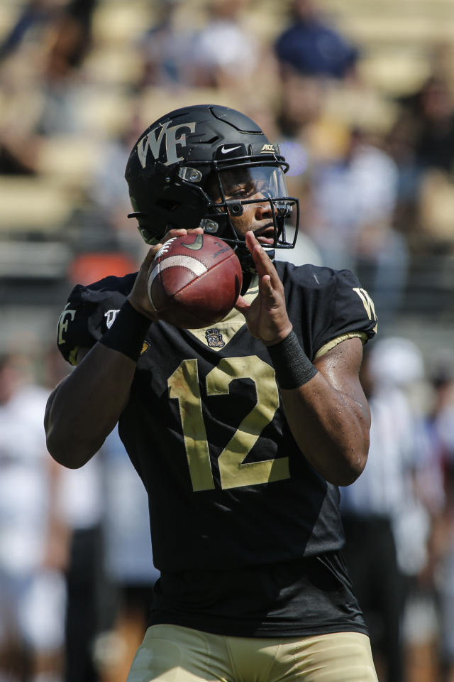 Wake Forest quarterback Jamie Newman looks to pass against Elon in the first half of an NCAA college football game in Winston-Salem, N.C., Saturday, Sept. 21, 2019. Wake Forest won 49-7. (AP Photo/Nell Redmond)