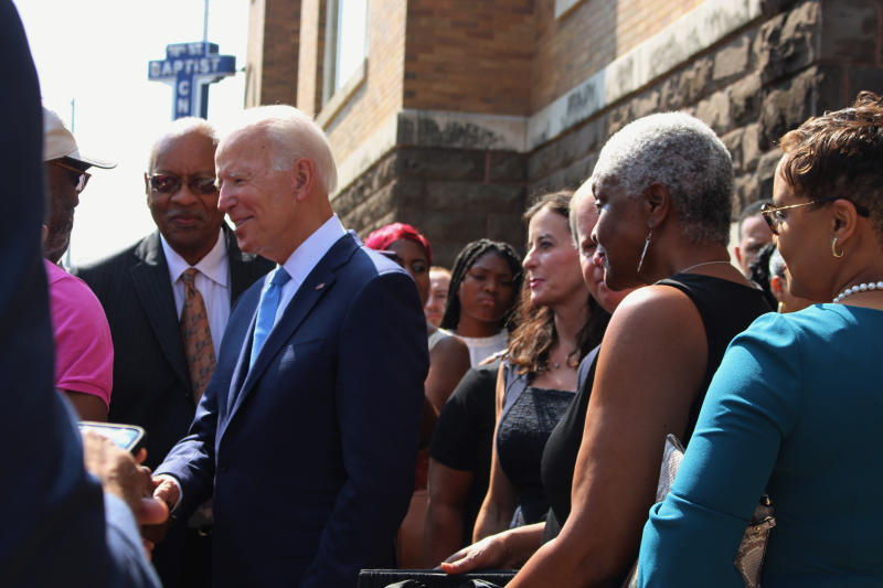 "Former Vice President and presidential candidate Joe Biden, center, left, speaks with an attendee as he joins Sen. Doug Jones and Birmingham Mayor Randall Woodfin at a wreath laying after a service at 16th Street Baptist Church in Birmingham, Ala., Sunday, Sept. 15, 2019. Visiting the black church bombed by the Ku Klux Klan in the civil rights era, Democratic presidential candidate Biden said Sunday the country hasn't ""relegated racism and white supremacy to the pages of history"" as he framed current tensions in the context of the movement's historic struggle for equality. (Ivana Hrynkiw/The Birmingham News via AP)"