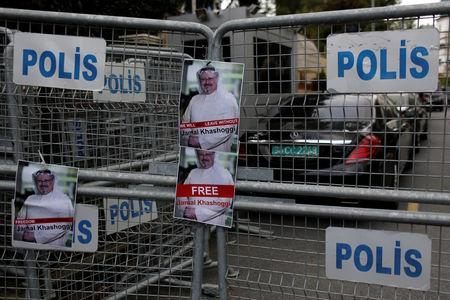 Pictures of Saudi journalist Khashoggi are placed on security barriers during a protest outside the Saudi Consulate in Istanbul, Turkey October 8, 2018. REUTERS/Murad Sezer