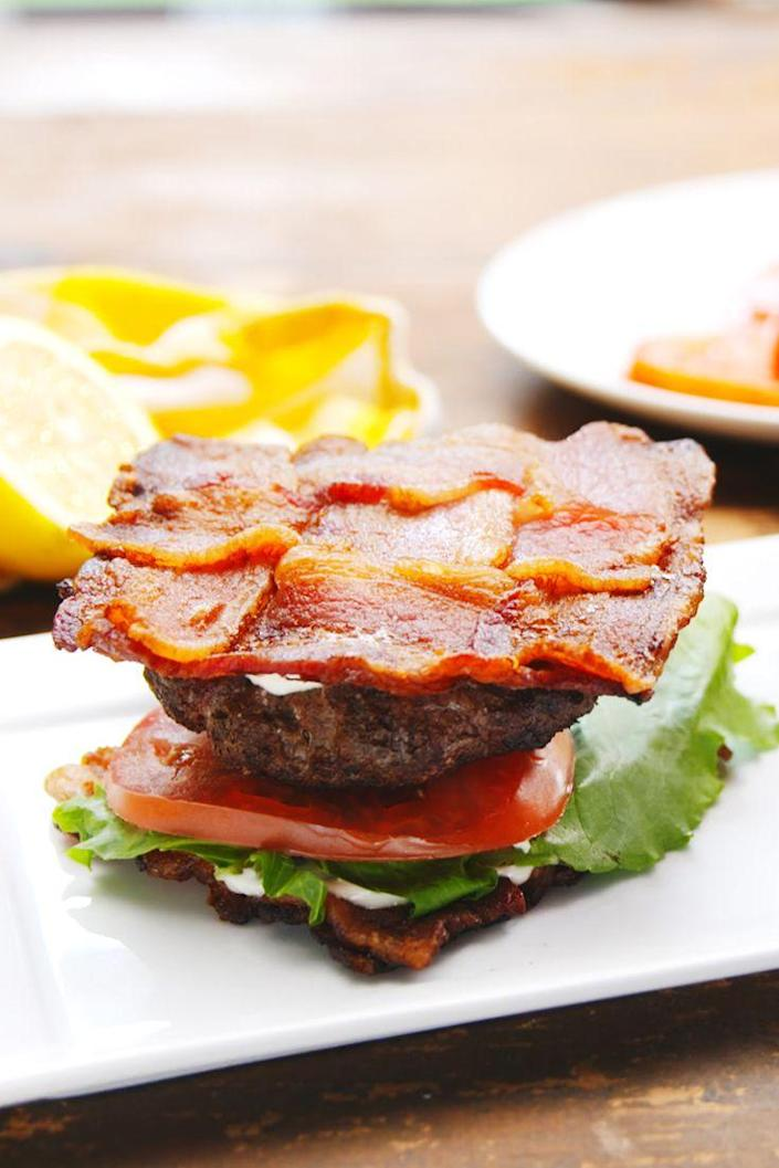 """<p>Everything is better with a bacon weave bun.</p><p>Get the recipe from <a href=""""https://delish.com/cooking/recipe-ideas/recipes/a54644/blt-burgers-recipe/"""" rel=""""nofollow noopener"""" target=""""_blank"""" data-ylk=""""slk:Delish"""" class=""""link rapid-noclick-resp"""">Delish</a>.</p>"""