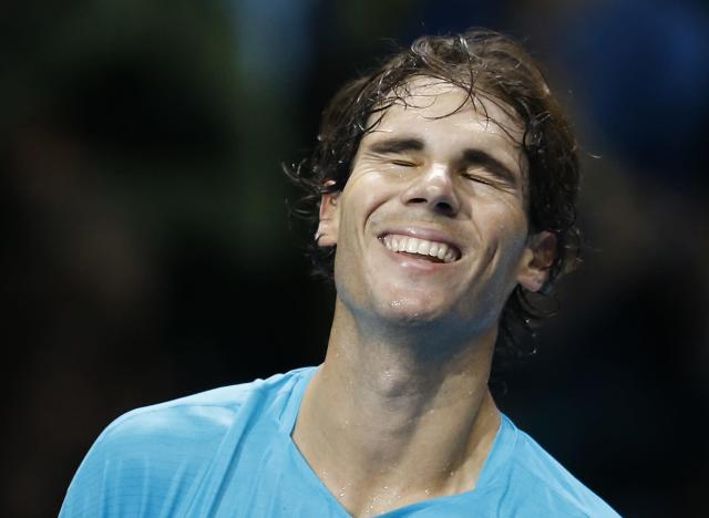 Rafael Nadal of Spain celebrates winning the match against David Ferrer of Spain during their ATP World Tour Finals singles tennis match at the O2 Arena in London, Tuesday, Nov. 5, 2013. (AP Photo/Kirsty Wigglesworth)