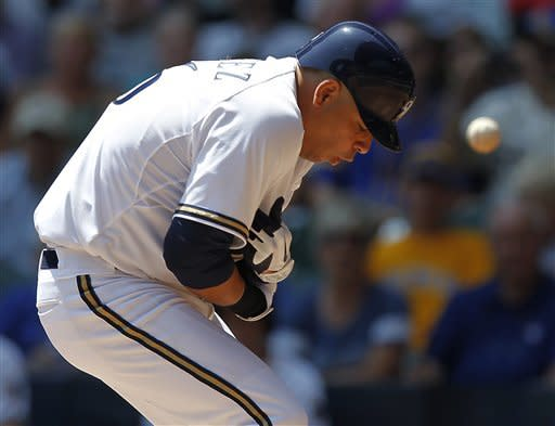 Milwaukee Brewers batter Aramis Ramirez grabs his arm after getting hit by St. Louis Cardinals starting pitcher Adam Wainwright during the first inning of a baseball game Wednesday, July 18, 2012, in Milwaukee. (AP Photo/Jeffrey Phelps)