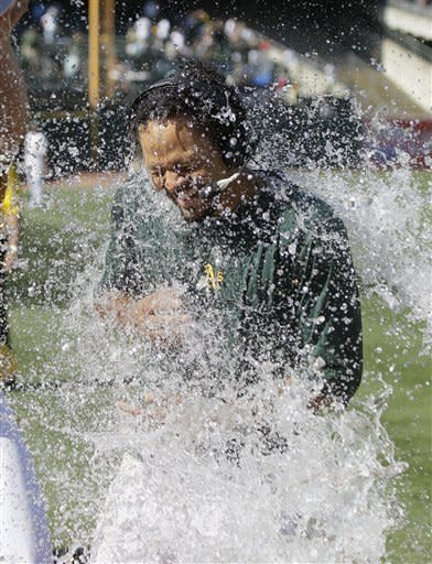 Oakland Athletics' Coco Crisp is doused at the end of their baseball game against the New York Yankees Sunday, July 22, 2012 in Oakland, Calif. Oakland won the game 5-4 to sweep their four-game series. Crisp drove in the winning run. (AP Photo/Eric Risberg)