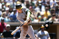 Oakland Athletics' Mark Canha hits an RBI single against the San Diego Padres in the fourth inning of a baseball game Wednesday, July 28, 2021, in San Diego. (AP Photo/Derrick Tuskan)