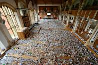 A selection of over 125,000 birthday cards sent to Captain Tom Moore, for his 100th birthday on April 30 2020 are displayed in the Great Hall of Bedford School