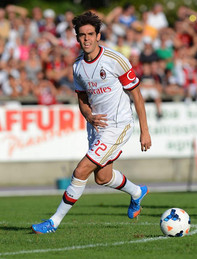 Milan's brazilian midfielder Kaka, centre, plays the ball during the friendly soccer match between Swiss Challenge League Club FC Chiasso and Italy's Serie A Club AC Milan, in Chiasso, southern Switzerland, Saturday Sept. 7 2013. (AP Photo/KEYSTONE/Gabriele Putzu)