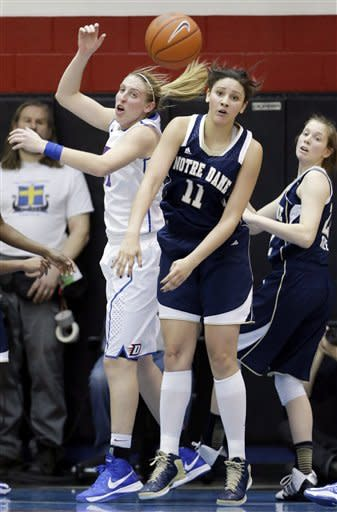 Notre Dame forward Natalie Achonwa, center, guard Madison Cable, right, and DePaul forward Katherine Harry, left, watch a loose ball during the first half of an NCAA women's college basketball game in Chicago on Sunday, Feb. 24, 2013. (AP Photo/Nam Y. Huh)