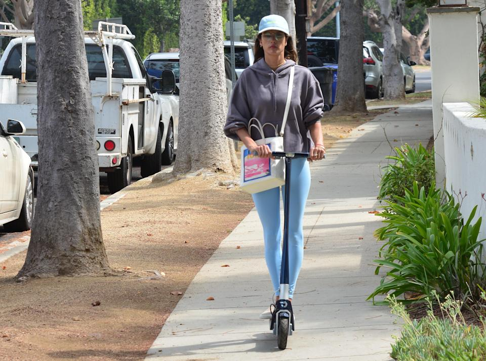 Alessandra Ambrosio was spotted on a scooter in Brentwood, California - Credit: London Entertainment / SplashNews.com