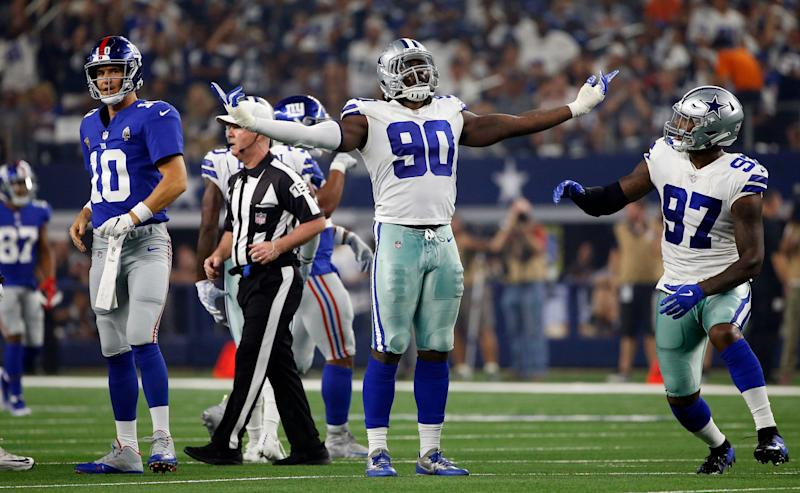 Dallas Cowboys defensive end Demarcus Lawrence (90) will get to face Eli Manning twice this season. (AP)