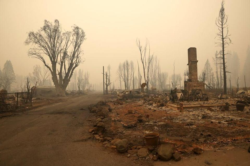 The burnt remains of a home that was destroyed by the Dixie Fire on August 12, 2021 in Greenville, California (Getty Images)