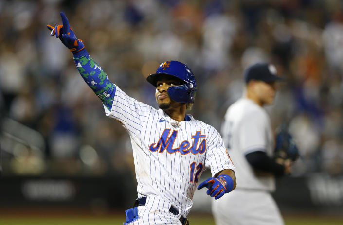 New York Mets' Francisco Lindor (12) reacts after his second home run in a baseball game against the New York Yankees in the sixth inning, Sunday, Sept. 12, 2021, in New York. (AP Photo/Noah K. Murray)