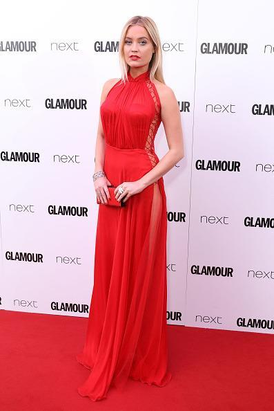<p>Red dresses seemed to be a popular choice at the Glamour Awards. Laura looked ravishing in this dress by Cristina Savulescu.<i> [Photo: Mike Marsland/Mike Marsland/WireImage]</i></p>
