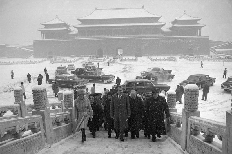 FILE - In this Feb. 25, 1972 file photo, then U.S. President Richard Nixon and first lady Pat Nixon enter the palace grounds of Beijing's Forbidden City as heavy snow falls on the Beijing, China. In the background is a fleet of Chinese made Hong Qi limousines. China is reviving the illustrious Red Flag marque, better known at home by its Chinese name, Hong Qi, courtesy of a government-backed program to promote domestic brands that dovetails neatly with efforts to step-up China's diplomatic profile, partly through a greater emphasis on the pomp and circumstance accompanying state visits. (AP Photo, File)