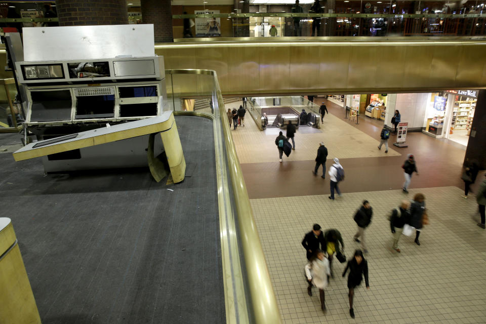 FILE — In this March 19, 2015 file photo, a portion of the old control center, left, sits idle at the Port Authority Bus Terminal in New York. New York City's main bus terminal, long ridiculed for leaky ceilings, dirty bathrooms and frequent delays, could be in for a major overhaul. The Port Authority of New York and New Jersey unveiled a plan Thursday, Jan. 21, 2021, to rebuild and expand the embattled midtown Manhattan bus terminal. (AP Photo/Seth Wenig, File)