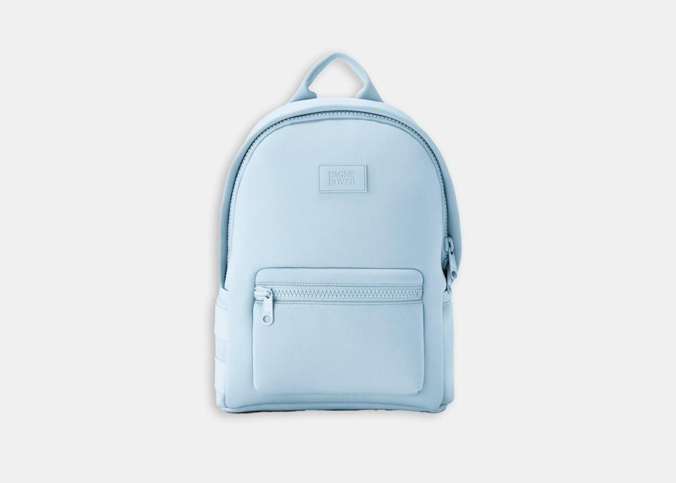 """Dagne Dover's Dakota medium backpack (one of our favorite <a href=""""https://www.cntraveler.com/gallery/8-best-travel-backpacks?mbid=synd_yahoo_rss"""" rel=""""nofollow noopener"""" target=""""_blank"""" data-ylk=""""slk:travel backpacks"""" class=""""link rapid-noclick-resp"""">travel backpacks</a>) will get you from your flight through a full day in the parks thanks to its plentiful pockets and pouches—like the clever zipped slots on either side of the bag to stow your phone and keep it readily accessible. The neoprene material is both water resistant and shock absorbent, ideal for protecting your belongings during rides on <a href=""""https://www.cntraveler.com/activities/orlando/splash-mountain?mbid=synd_yahoo_rss"""" rel=""""nofollow noopener"""" target=""""_blank"""" data-ylk=""""slk:Splash Mountain"""" class=""""link rapid-noclick-resp"""">Splash Mountain</a> or <a href=""""https://www.cntraveler.com/activities/orlando/the-twilight-zone-tower-of-terror?mbid=synd_yahoo_rss"""" rel=""""nofollow noopener"""" target=""""_blank"""" data-ylk=""""slk:The Twilight Zone Tower of Terror"""" class=""""link rapid-noclick-resp"""">The Twilight Zone Tower of Terror</a>. $195, Nordstrom. <a href=""""https://www.nordstrom.com/s/dagne-dover-large-dakota-backpack/5327368"""" rel=""""nofollow noopener"""" target=""""_blank"""" data-ylk=""""slk:Get it now!"""" class=""""link rapid-noclick-resp"""">Get it now!</a>"""