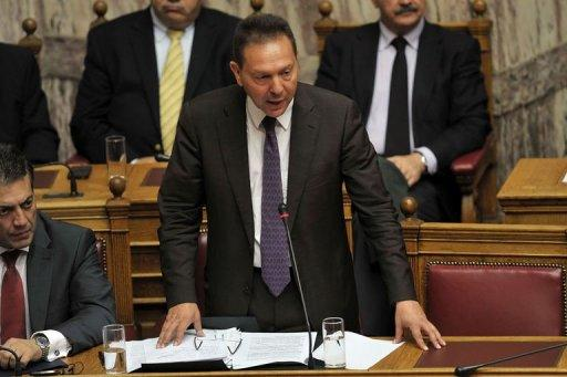 Greek finance minister Yiannis Stournaras gives a speech at the Greek parliament in Athens. The coalition government of Antonis Samaras won the largely symbolic confidence vote, winning a comfortable mandate to tackle the country's two-year-old crisis