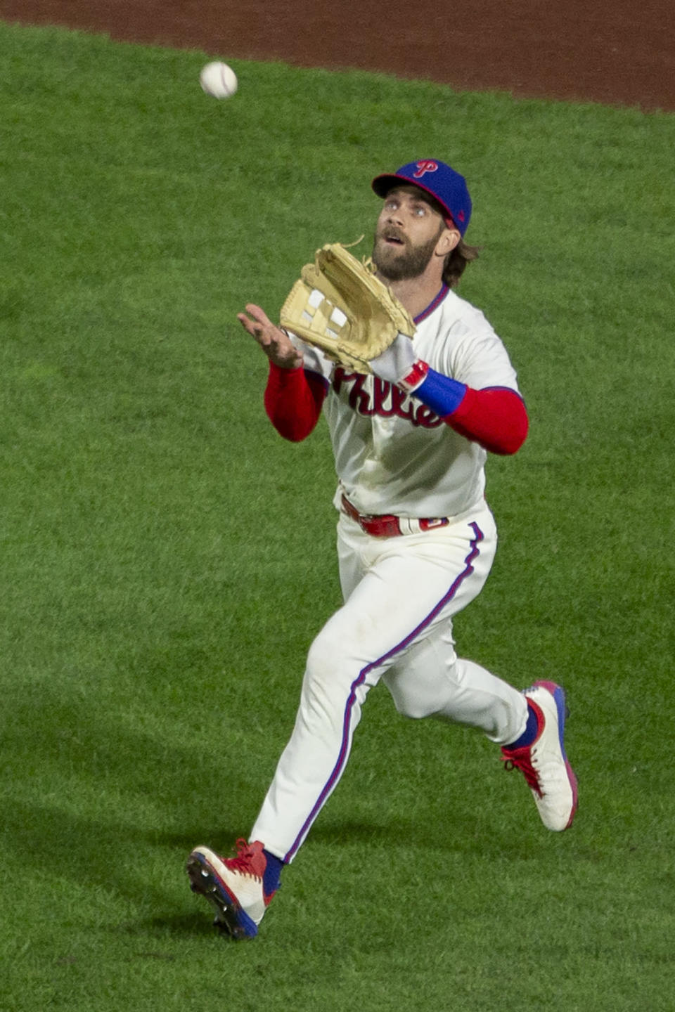 Philadelphia Phillies right fielder Bryce Harper (3) catches a fly during the fourth inning of a baseball game, Saturday, Sept. 19, 2020, in Philadelphia. (AP Photo/Laurence Kesterson)
