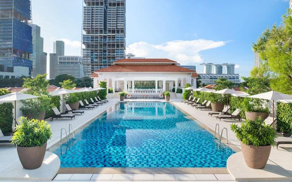 The rooftop swimming pool has been remodelled and now feels twice as large thanks to the addition of ivory-white floor tiles and outdoor furniture - TOOTEN