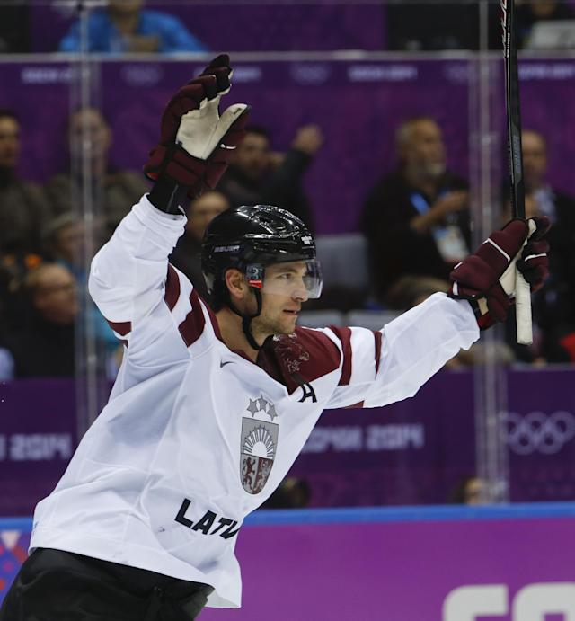 Latvia forward Lauris Darzins reacts after scoring a shorthanded goal against Switzerland in the third period of a men's ice hockey game at the 2014 Winter Olympics, Tuesday, Feb. 18, 2014, in Sochi, Russia. (AP Photo/Mark Humphrey)